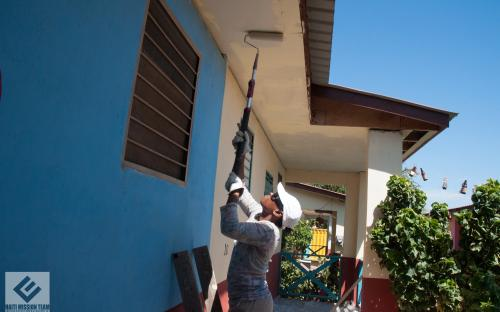 Painting the porch of one of the houses